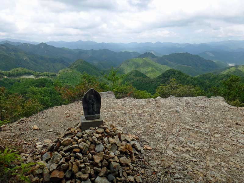 stone juzo on the mountain tops with Walk Japan