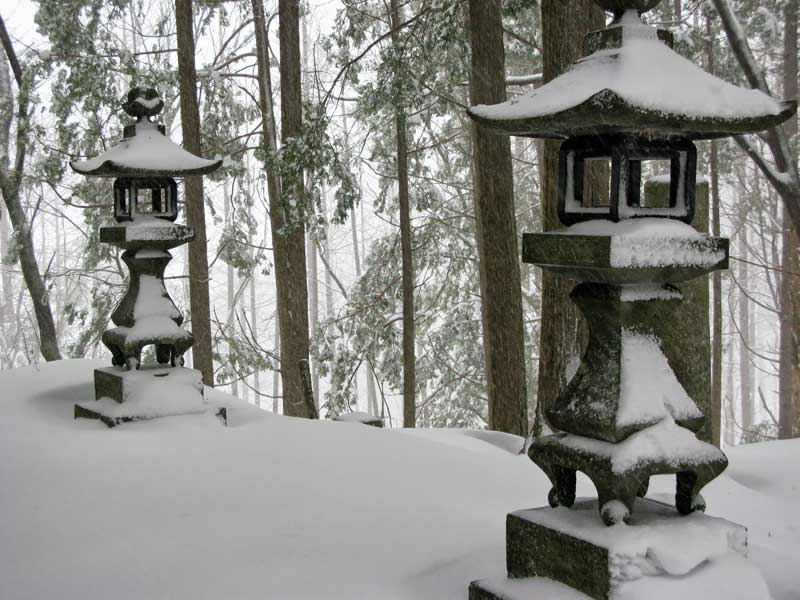 Japanese stone lanterns in the snow, Torii Pass
