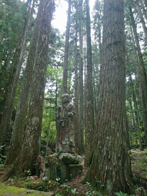 statue in the woods at Nyonindo Koyasan
