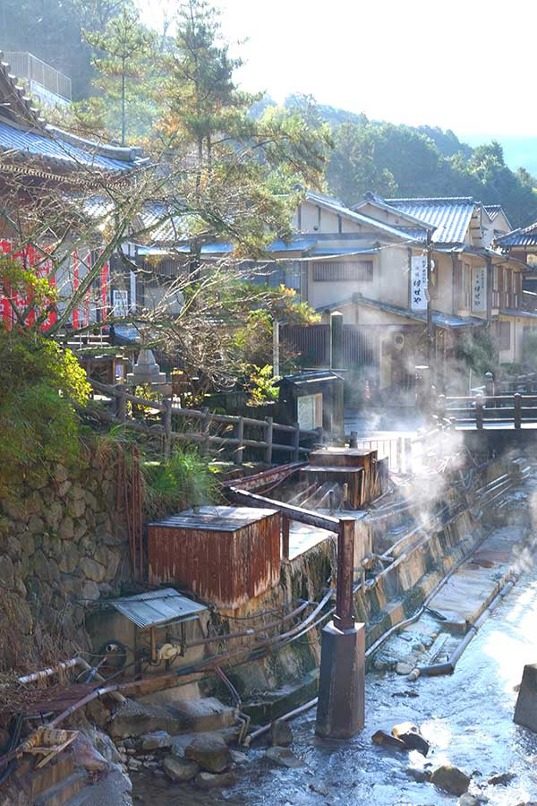Steaming hot water from the natural geothermal river in Younomine hot spring town