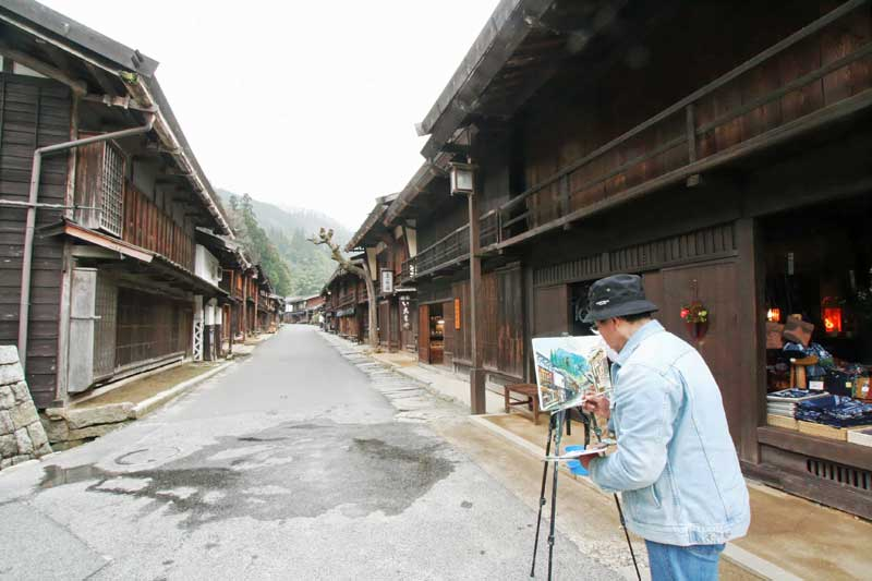 painting traditional wooden houses in tsumago post town